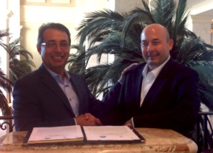 Port Tampa Bay Exec Vice President/Chief Commercial Officer Raul Alfonso (left), celebrates the signing of a joint MOU agreement with Giovanni Benedetti, commercial director of the Port of Cartagena, at the Marriott Waterside Hotel, in Tampa.