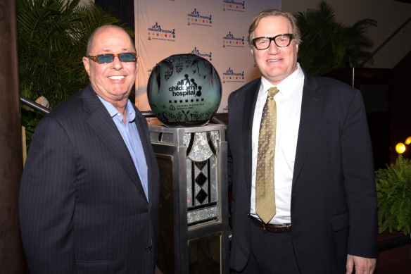 Bill Edwards (left) receives the William Belcher Award from the All Children's Hospital Foundation from Dr. Jonathan Ellen president of All Children's Hospital Foundation and president and physician-in-chief at All Children's Hospital Johns Hopkins Medicine.