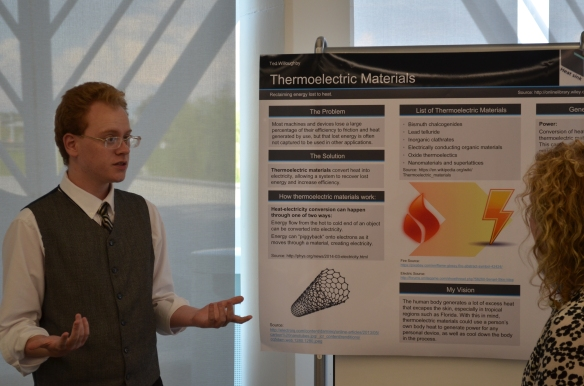 Ted Willoughby of Wesley Chapel High School presents his poster at the conclusion of the MERIT graduation. Each MERIT participant chose a topic involving advanced technology that they researched for a poster presentation.
